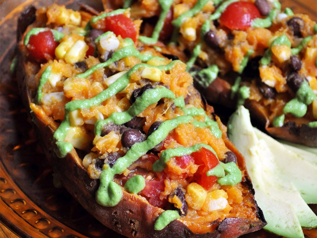 Foil wrapped baked sweet potatoes and chili edited